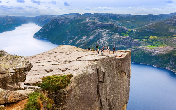 People standing on Prekestolen platou with a view over Lysefjorden.