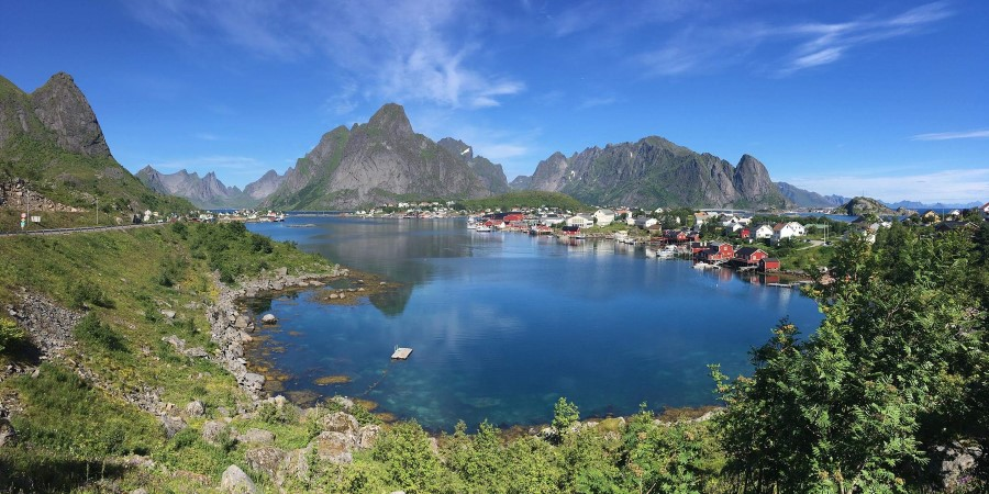 An island in the middle of Lofoten surrounded by a body of water